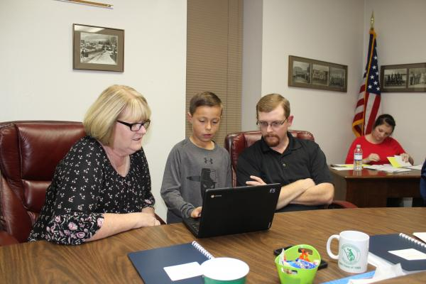 The G/T students from North Elementary demonstrated two math programs to BISD board members Monday, Oct. 15. This is Cooper Wimberley between Paige Townson and Russell Creager showing them how the math program works. BA photo by Jean Hayworth