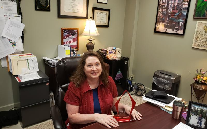 Debbie Karl sits with her award in her office. BA photo by James Norman
