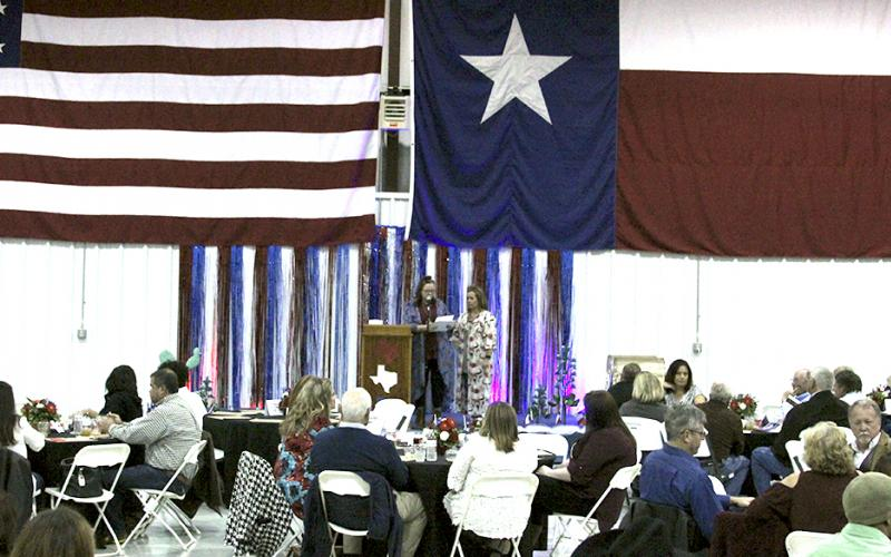 Hundreds gather in a hanger at Stephens County Airport during the annual Breckenridge Chamber of Commerce.