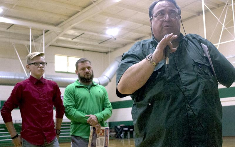 Breckenridge Junior High School student Casey Jameson and BJHS teacher Donny Funderburg look on as KEEN radio personality Rudy Fernandez talks to a crowd of BJHS students on hand for the ceremony.