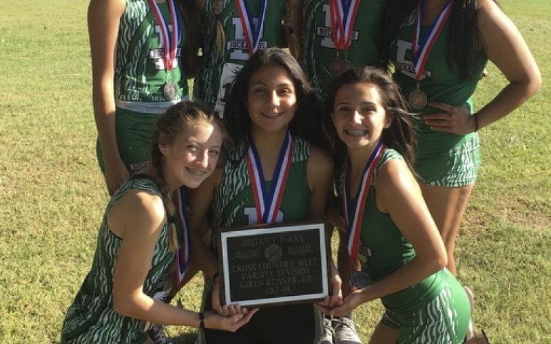 The Lady Buckaroo Cross Country Team poses for a photo with their second-place plaque.