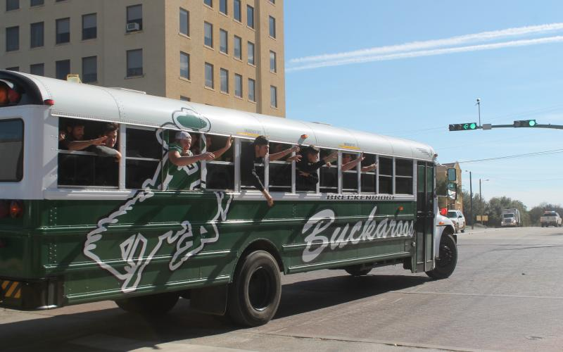 The Bucks football team rode up to Walker Street on Thursday, as they were sent off before their playoff game. BA photo by James Norman