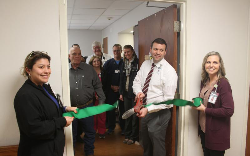 Stephens County Memorial Hospital CEO Matt Kempton cuts the ribbon to open the new nuclear lab facility. BA photo by James Norman