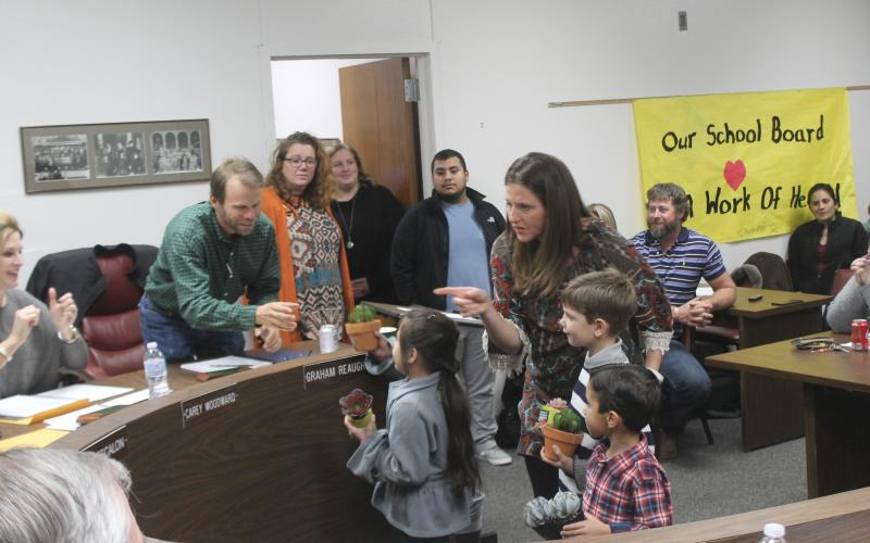 BISD students gave speeches they memorized to the board members and gave them each a potted plant for decoration for School Board Appreciation Month. BA photo by James Norman
