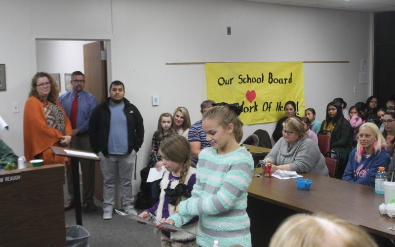 Students from BISD read letters and then give out candy to each board member in honor of School Board Appreciation Month. BA photo by James Norman