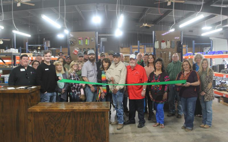 Gary Drake gets ready to cut the ribbon for Boss Oilfield Supply. Several representatives from Boss and the city were on-hand to cut the ribbon to signify the opening of the new business. Though, the business has been open since October of last year. BA photo by James Norman