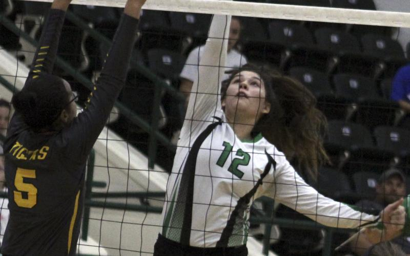 Breckenridge middle hitter Calista Lambert makes a kill.