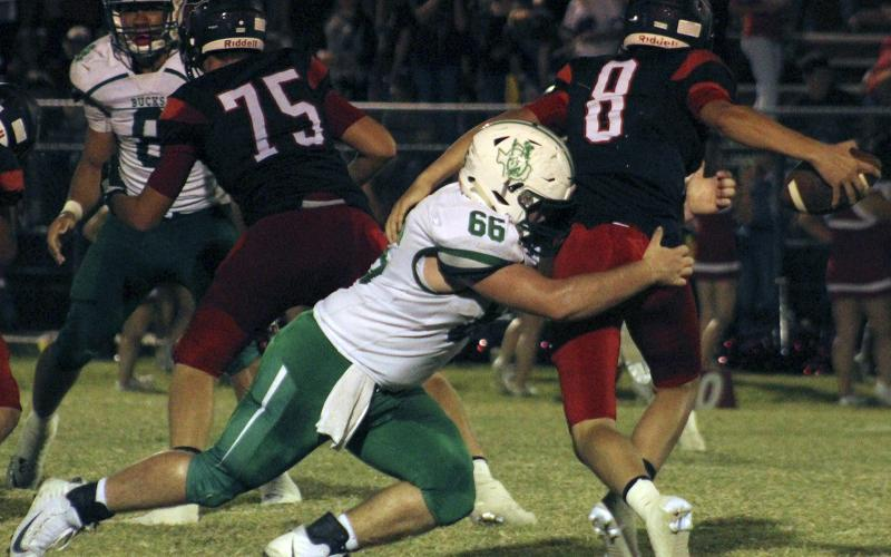 Junior defensive lineman Lane Berkley sacks Eastland's quarterback.