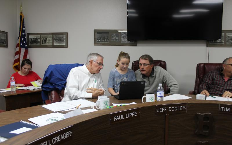 BISD board members Paul Lippe and Jeff Dooley are being schooled on a G/T math program by third-grader Teagan Deen, who is demonstrating a math problem on her Chrome Book that is used at North Elementary. BA photo by Jean Hayworth