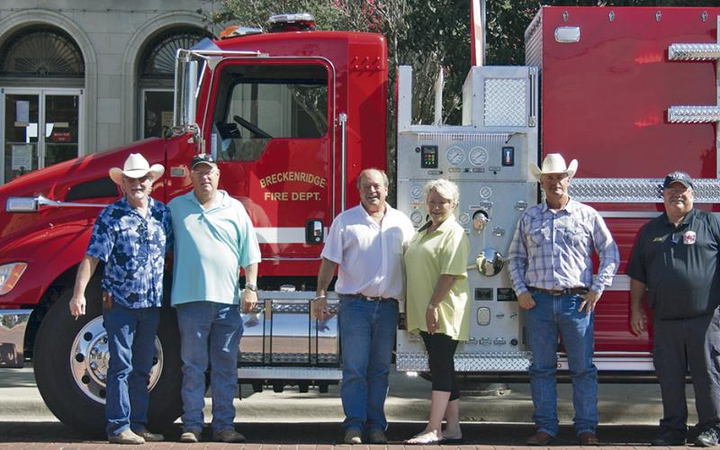 From left, Stephens County Commissioners Rick Carr, Ed Russell, Judge Gary Fuller, Darlene Taylor with Deep South Fire Trucks Commissioner Will Warren and Breckenridge Fire Department Chief Calvin Chaney pose for a photo in front BFD's  new tanker.