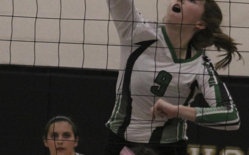 Sophomore Madison Stanley slams the ball past Jim Ned defenders during  UIL Bi-District Playoff Game in Abilene. The Lady Buckaroos fell in five sets.