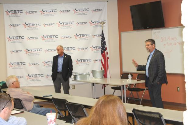 Texas Rep. Mike Lang (left) and Texas Sen. Charles Perry (right) talk with residents and officials about the issues in the state. The town hall featured discussion on several issues. BA photo by James Norman