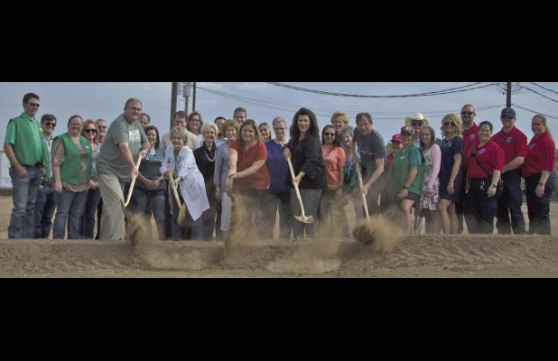 Various area government and business officials break ground on a new facility that should open sometime in 2018.