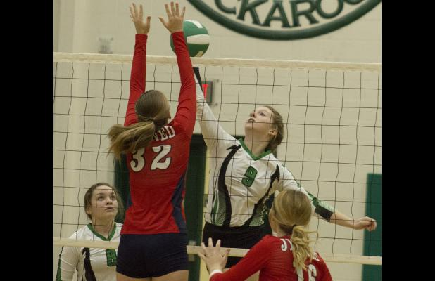 Sophomore outside hitter Madison Stanley tips the ball past a Jim Ned defender.