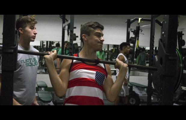 Breckenridge High School freshman Jonas Arellano racks a weight bar after a set of lunges Monday during the Buckaroo football team's offseason strength and conditioning program. Arellano hopes to make an immediate impact this season.