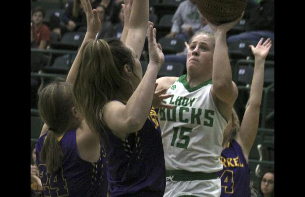 Swarmed by Merkel defenders, Breckenridge senior Carley Tennison puts in a basket Monday night. Tennison led the Lady Bucks in scoring with 11 points.