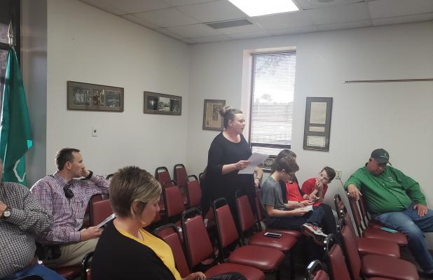 Amy Loftis gives comment to the board and details her concerns about bullying within the district. BA photo by James Norman