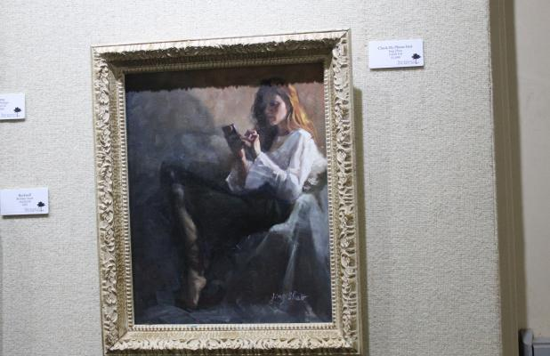 """The Breckenridge Fine Arts Center is hosting the Portrait Society of America exhibit with the First Place awarded to Jing ZHao for her oil painting titled, """"Check My Phone First."""" BA photo by James Norman"""
