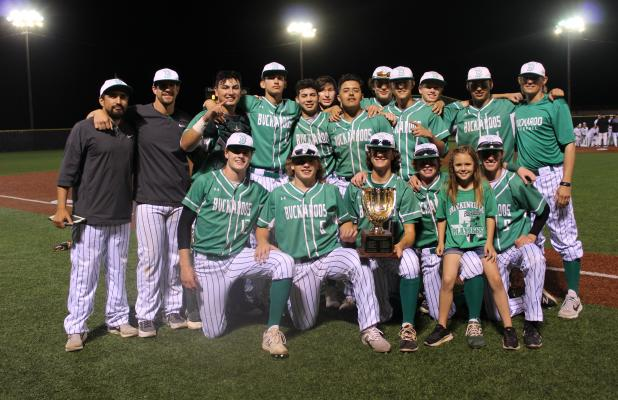 The Bucks baseball team poses with their new hardware after besting the Henrietta Bearcats 9-1 and 10-0. BA photo by James Norman