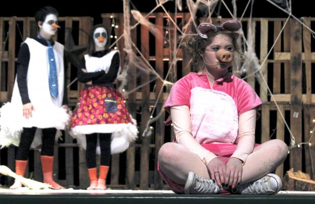 First-time stage actress Savannah Burns performs as Wilbur in 'Charlotte's Web'.