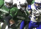 A Breckenridge Junior High School running back rushes for a big gain during last Thursday's season finale.