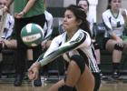 Defensive specialist Aylin Saucedo gets under an opponent's kill.